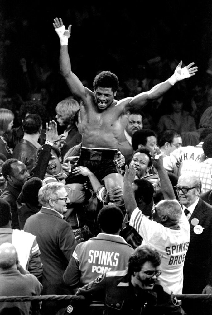 FILE - In this Feb. 15, 1978, file photo, Leon Spinks celebrates as his entourage holds him aloft after his 15-round split decision victory over world heavyweight boxing champion Muhammad Ali in Las Vegas.  Former heavyweight champion Leon Spinks Jr. died Friday night, Feb. 5, 2021, after battling prostate and other cancers. He was 67. (AP Photo/Lenny Ignelzi, File)