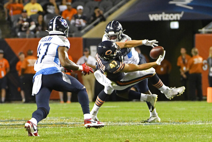 Chicago Bears tight end Jesper Horsted (47) makes a catch against Tennessee Titans David Long Jr. (51) and defensive back JoJo Tillery (47) during the first half of an NFL preseason football game Thursday, Aug. 29, 2019, in Chicago. (AP Photo/David Banks)