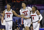 Louisville's Khwan Fore (4), Jordan Nwora (33) and Dwayne Sutton (24) celebrate in a timeout during the second half of an NCAA college basketball game in the Atlantic Coast Conference tournament in Charlotte, N.C., Wednesday, March 13, 2019. (AP Photo/Chuck Burton)