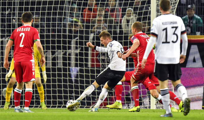 Germany's Toni Kroos scores his side's 4th goal during the Euro 2020 group C qualifying soccer match between Germany and Belarus in Moenchengladbach, Germany, Saturday, Nov. 16, 2019. (AP Photo/Martin Meissner)