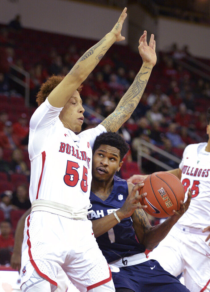 Utah State's Tauriawn Knight, right, drives into Fresno State's Noah Blackwell before taking a shot during an NCAA college basketball game in Fresno, Calif., Tuesday, Feb. 5, 2019. (Craig Kohlruss/The Fresno Bee via AP)