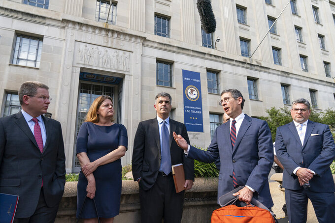 FILE - In this June 14, 2021 file photo, Bruce Brown, fourth from left, executive director of the Reporters Committee for Freedom of the Press, speaks accompanied by CNN's Washington Bureau Chief Sam Feist, left, Washington Post Executive Editor Sally Buzbee, Washington Post general counsel Jay Kennedy, CNN executive vice president and general counsel David Vigilante, right, after a meeting with Attorney General Merrick Garland at the Department of Justice, in Washington. (AP Photo/Alex Brandon)