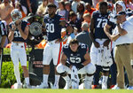Auburn players look on from the sideline as the game gets away from them during the second half of an NCAA college football game against Tennessee , Saturday, Oct. 13, 2018, in Auburn, Ala. (AP Photo/Vasha Hunt)