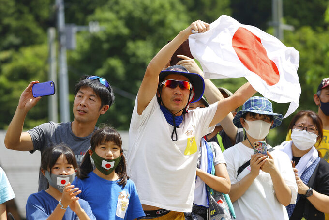 Fans contemplate the men's road race at the 2020 Summer Olympics, Saturday, July 24, 2021, in Oyama, Japan. (Tim de Waele/Pool Photo via AP)