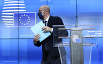 European Council President Charles Michel steps away from the podium after speaking during a media conference at an EU summit in Brussels, Thursday, Oct. 15, 2020. European Union leaders met in person for the first day of a two-day summit, amid the worsening coronavirus pandemic, to discuss topics ranging from Brexit to climate and relations with Africa. (Kenzo Tribouillard, Pool via AP)