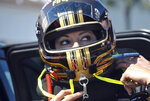 """FILE - Drag racer Leah Pritchett, now Leah Pruett, tightens her helmet before making a pass at the NHRA Gatornationals at Gainesville Raceway, in Gainesville, Fla., in this Saturday, March 17, 2018, file photo. Tony Stewart, who fell in love with NHRA while tagging along with fiancée Leah Pruett at her races the past two seasons, will be an official part of the sport in 2022. The NASCAR Hall of Fame driver will add two fulltime NHRA entries to Tony Stewart Racing next season — a Top Fuel entry for Pruett and a Funny Car for Matt Hagan. """"It's a very unique opportunity to control my own destiny with my almost-husband in a sport I'm absolutely passionate about,"""" Pruett told The Associated Press. (AP Photo/Mark Long, File)"""