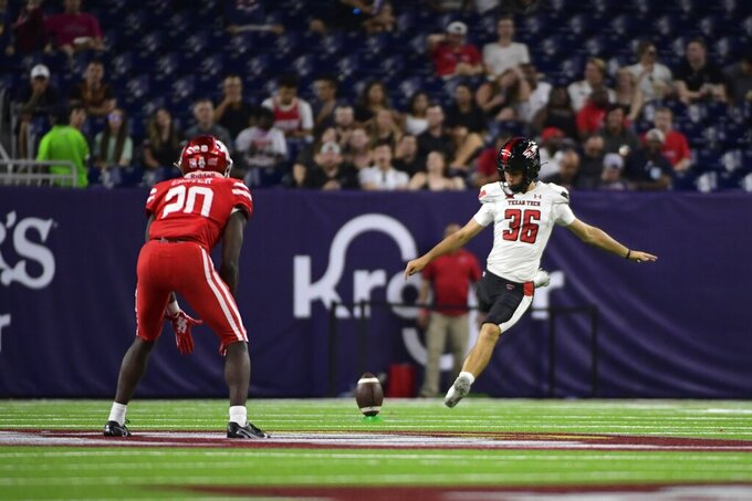 Texas Tech place kicker Trey Wolff (36) kicks to Houston during the second half of an NCAA college football game Saturday, Sept. 4, 2021, in Houston. (AP Photo/Justin Rex)
