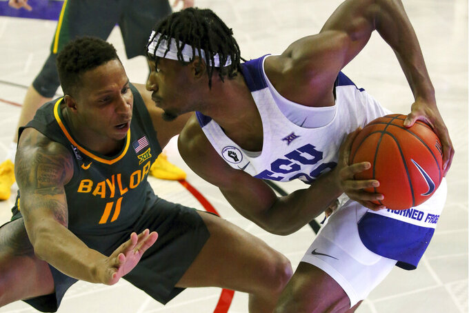 Baylor guard Mark Vital (11) defends against TCU guard RJ Nembhard (22) in the first half of an NCAA college basketball game, Saturday, Jan. 9, 2021, in Fort Worth, Texas. (AP Photo/ Richard W. Rodriguez)