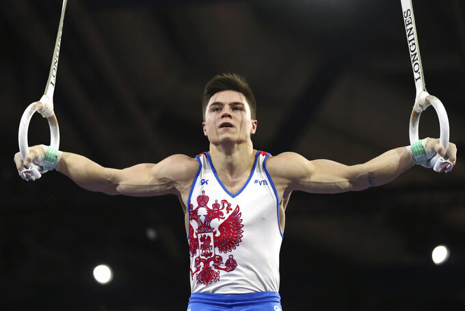 FILE - Nikita Nagornyy of Russia performs on the rings in the men's all-around final at the Gymnastics World Championships in Stuttgart, Germany, in this Friday, Oct. 11, 2019, file photo. Russia, China and potentially host Japan figure to be in a fight for the top of the podium in the team event at the Tokyo Games. Nagornny, the 2019 world all-around champion, leads the field in the men's all around. (AP Photo/Matthias Schrader, File)