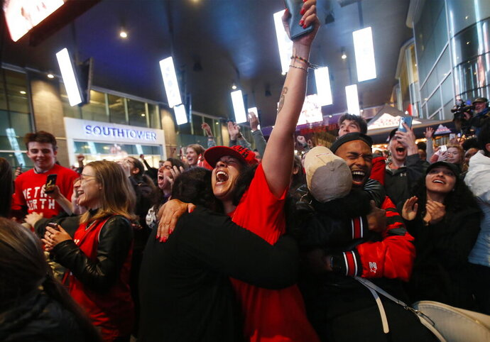 Toronto Raptors fans celebrate at a public telecast early Friday, June 14, 2019, in Halifax, Nova Scoatia, following the Raptors' 114-110 win over the Golden State Warriors in Oakland, Calif., in Game 6 of basketball's NBA Finals. (Tim Krochak/The Canadian Press via AP)