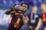 Ohio State wide receiver Parris Campbell runs a drill at the NFL football scouting combine in Indianapolis, Saturday, March 2, 2019. (AP Photo/Michael Conroy)