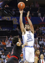 North Carolina's Luke Maye (32) shots over Louisville's Jordan Nwora (33) during the first half of an NCAA college basketball game in the Atlantic Coast Conference tournament in Charlotte, N.C., Thursday, March 14, 2019. (AP Photo/Chuck Burton)