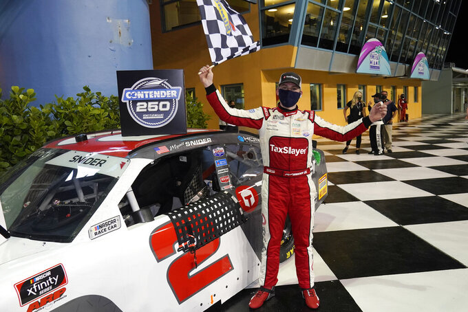 Myatt Snider celebrates after winning the NASCAR Xfinity Series auto race Saturday, Feb. 27, 2021, at Homestead-Miami Speedway in Homestead, Fla. (AP Photo/Wilfredo Lee)