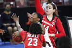 South Carolina forward Aliyah Boston attempts a shot against Georgia guard Que Morrison (23) and Jenna Staiti (14) during the first half of an NCAA college basketball game Thursday, Jan. 21, 2021, in Columbia, S.C. (AP Photo/Sean Rayford)