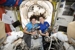 In this photo released by NASA on Thursday, Oct. 17, 2019, U.S. astronauts Jessica Meir, left, and Christina Koch pose for a photo in the International Space Station. On Friday, Oct. 18, 2019, the two are scheduled to perform a spacewalk to replace a broken battery charger. (NASA via AP)