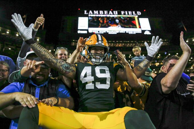 Green Bay Packers' Evan Baylis celebrates his touchdown catch during the first half of a preseason NFL football game against the Kansas City Chiefs Thursday, Aug. 29, 2019, in Green Bay, Wis. (AP Photo/Matt Ludtke)