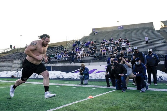 UW Whitewater lineman Quinn Meinerz runs at the school's pro football day Tuesday, March 9, 2021, in Whitewater, Wisc. The only FCS teams hosting pro days this year were Central Arkansas, North Dakota State and South Dakota State. Division III Wisconsin-Whitewater held one only because its Senior Bowl revelation, offensive lineman Quinn Meinerz, warranted another look after his team did not play in the fall. (AP Photo/Morry Gash)