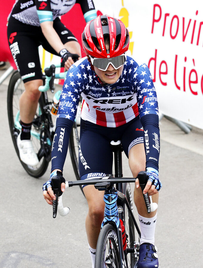 File-This April 21, 2021, file photo shows U.S. rider Ruth Winder of the Trek Segafredo in action during the Women's Belgian cycling classic and UCI World Tour race Fleche Wallonne, in Huy, Belgium. The cycling team that the U.S. is taking to the Tokyo Olympics is a little bit different than the one it would have taken a year ago, when the COVID-19 pandemic forced organizers to postpone the Summer Games by an entire year. In many ways,  the team announced Thursday, June 10, 2021, is a whole lot stronger.  Chloe Dygert, who sustained a serious injury during a crash last fall, will be busy during the three weeks in Tokyo. The 2019 world time trial champ will join Amber Neben in the race against the clock, and both of them will join Winder, Coryn Rivera and Leah Thomas as the Americans try to upset the heavily favored Dutch in the women's road race. (AP Photo/Olivier Matthys, File)