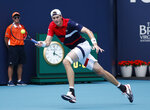 John Isner of USA, returns a volley to Albert Ramos-Vinglas of Spain, during the Miami Open tennis tournament, Sunday, March 24, 2019, in Miami Gardens, Fla. (AP Photo/Joel Auerbach)