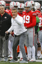 FILE - In this Saturday, Nov. 24, 2018, file photo, Ohio State head coach Urban Meyer instructs his team during an NCAA college football game against Michigan in Columbus, Ohio. How far will Ohio State move up the latest College Football Playoff rankings? Can the Buckeyes pass Oklahoma? The updated CFP rankings are released Tuesday, Nov. 27, 2018. (AP Photo/Jay LaPrete, File)