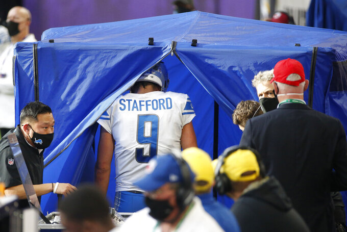 Detroit Lions quarterback Matthew Stafford (9) enters the injury after getting injured during the second half of an NFL football game against the Minnesota Vikings, Sunday, Nov. 8, 2020, in Minneapolis. (AP Photo/Bruce Kluckhohn)