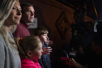 Kentucky Attorney General and Democratic Gubernatorial candidate Andy Beshear stands with his family while speaking with the media after voting Tuesday, Nov. 5, 2019, in Louisville, Ky. (AP Photo/Bryan Woolston)