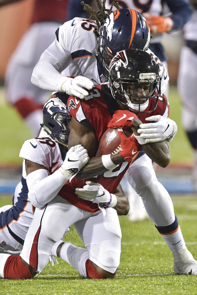 Atlanta Falcons wide receiver Christian Blake catches a pass during the first half of the team's Pro Football Hall of Fame NFL preseason game against the Denver Broncos, Thursday, Aug. 1, 2019, in Canton, Ohio. (AP Photo/David Richard)