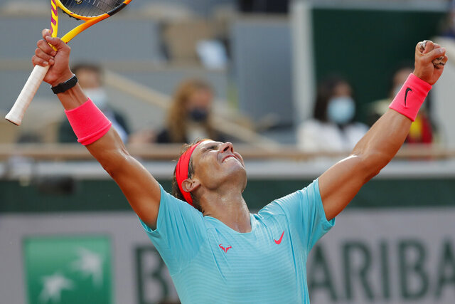 Spain's Rafael Nadal celebrates winning the semifinal match of the French Open tennis tournament against Argentina's Diego Schwartzman in three sets, 6-3, 6-3, 7-6, at the Roland Garros stadium in Paris, France, Friday, Oct. 9, 2020. (AP Photo/Michel Euler)