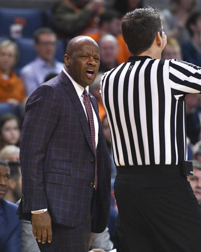 Arkansas head coach Mike Anderson talks to an official during the first half of an NCAA college basketball game against Auburn Wednesday, Feb. 20, 2019, in Auburn, Ala. (AP Photo/Julie Bennett)