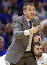 Buffalo coach Nate Oats yells instructions to players during the second half against Bowling Green in an NCAA college basketball game for the Mid-American Conference men's tournament title Saturday, March 16, 2019, in Cleveland. Buffalo won 87-73. (AP Photo/Tony Dejak)