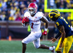 Rutgers running back Isaih Pacheco (1) rushes against Michigan defensive back DJ Turner (5) in the fourth quarter of an NCAA college football game in Ann Arbor, Mich., Saturday, Sept. 25, 2021. Michigan won 20-13. (AP Photo/Tony Ding)