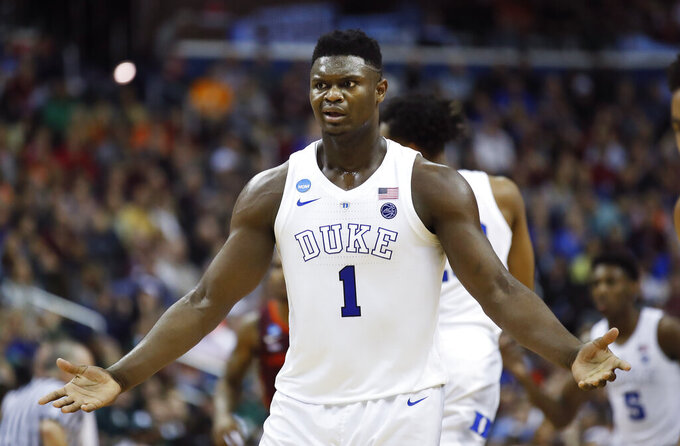 Duke forward Zion Williamson (1) reacts to a referee's call during the second half of the team's NCAA men's college basketball tournament East Region semifinal against Virginia Tech in Washington, Friday, March 29, 2019. (AP Photo/Alex Brandon)