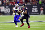 Houston Texans quarterback Deshaun Watson (4) scrambles away from Buffalo Bills defensive end Jerry Hughes (55) during the second half of an NFL wild-card playoff football game Saturday, Jan. 4, 2020, in Houston. (AP Photo/Michael Wyke)