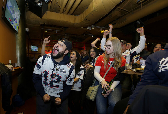 New England Patriots cheer while watching the second half of the NFL Super Bowl 53 football game in Atlanta between the Patriots and the Los Angeles Rams at a bar in Boston Sunday, Feb. 3, 2019. (AP Photo/Steven Senne)