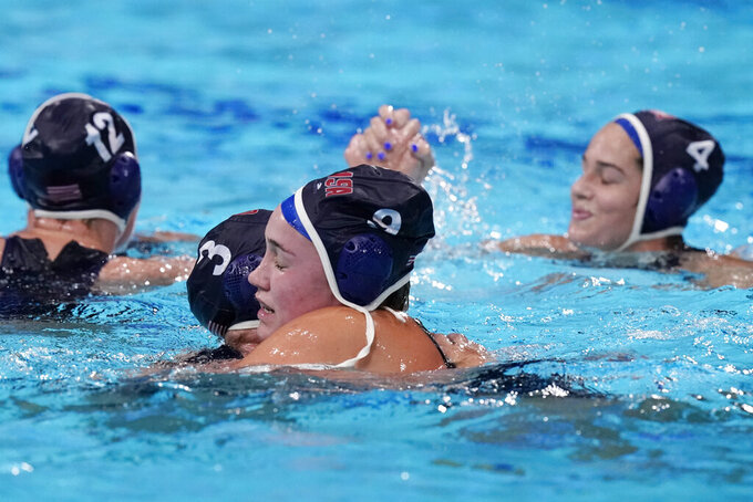 United States' Melissa Seidemann (3) and Aria Fischer (9) celebrate after a win against the Russian Olympic Committee in a semifinal round women's water polo match at the 2020 Summer Olympics, Thursday, Aug. 5, 2021, in Tokyo, Japan. (AP Photo/Mark Humphrey)