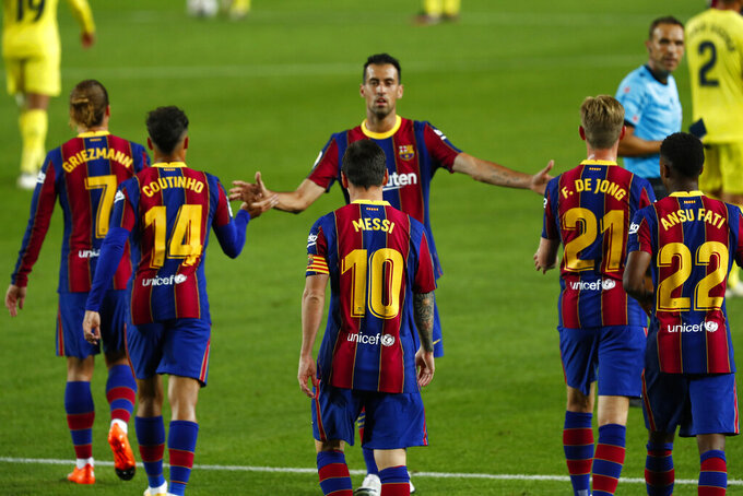 Barcelona's Lionel Messi celebrates with team mates after scoring his side's 3rd goal during the Spanish La Liga soccer match between FC Barcelona and Villareal FC at the Camp Nou stadium in Barcelona, Spain, Sunday, Sept. 27, 2020. (AP Photo/Joan Monfort)
