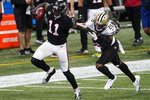 Atlanta Falcons wide receiver Julio Jones (11) runs against New Orleans Saints cornerback P.J. Williams (26) during the first half of an NFL football game, Sunday, Dec. 6, 2020, in Atlanta. (AP Photo/John Bazemore)
