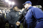 Vanderbilt head coach Derek Mason, left, meets ETSU head coach Randy Sanders on the field after an NCAA college football game Saturday, Nov. 23, 2019, in Nashville, Tenn. Vanderbilt won 38-0. (AP Photo/Mark Humphrey)