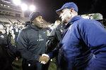 Vanderbilt head coach Derek Mason, left, meets ETSU head coach Randy Sanders on the field after an NCAA college football game Saturday, Nov. 23, 2019, in Nashville, Tenn. Vanderbilt won 38-0. (AP Photo/Mark Humphrey)