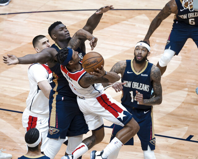 Washington Wizards guard Bradley Beal (3) is fouled as he shoots by New Orleans Pelicans forward Zion Williamson (1) in the second quarter of an NBA basketball game in New Orleans, Wednesday, Jan. 27, 2021. (AP Photo/Derick Hingle)