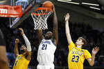 Villanova's Dhamir Cosby-Roundtree (21) goes up for a dunk against La Salle's Sherif Kenney (4) and Brandon Stone (23) during the second half of an NCAA college basketball game, Sunday, Dec. 1, 2019, in Villanova, Pa. (AP Photo/Matt Slocum)