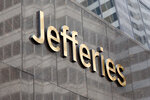 This May 23, 2019, photo shows the logo for the Jefferies Financial Group in New York. CEO Richard Handler was the third-highest paid CEO at big U.S. companies for 2018, as calculated by The Associated Press and Equilar, an executive data firm. He made $44.7 million. (AP Photo/Richard Drew)