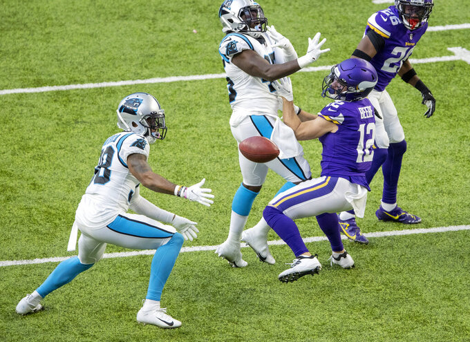 Minnesota Vikings punt returner Chad Beebe (12) muffs a punt which was recovered by the Carolina Panthers in the fourth quarter of an NFL football game in Minneapolis, Sunday, Nov. 29, 2020. (Carlos Gonzalez/Star Tribune via AP)