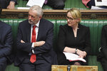 In this photo issued by the UK Parliament, showing Britain's main opposition Labour Party leader Jeremy Corbyn, left, sitting with lawmaker Rebecca Long-Bailey during the traditional parliamentary session Prime Minister's Questions inside the House of Commons in London Wednesday Jan. 15, 2020. Rebecca Long-Bailey is a contender to become leader of the Labour Party. (Jessica Taylor/UK Parliament via AP)