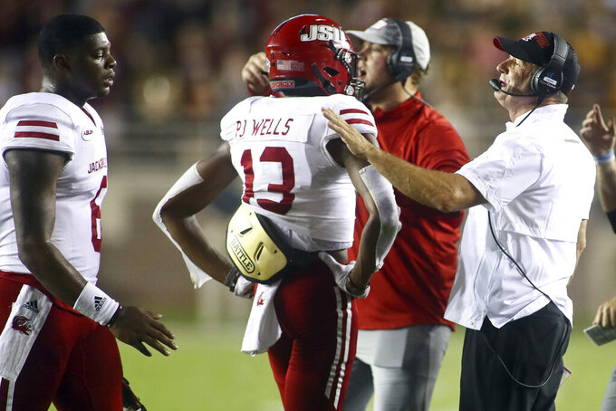 Jacksonville State head football coach John Grass, right, speaks to quarterback Zerrick Cooper (6) in the second quarter of an NCAA college football game against Florida State Saturday, Sept. 11, 2021, in Tallahassee, Fla. (AP Photo/Phil Sears)