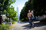 Cyclists ride down a path near the Hudson River during high temperatures on Saturday, July 20, 2019 in New York. Temperatures in the high 90s are forecast for Saturday and Sunday with a heat index well over 100. Much of the nation is also dealing with high heat. One World Trade Center is seen in the background. (AP Photo/Eduardo Munoz Alvarez)