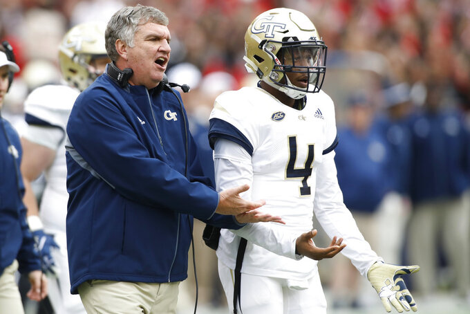 Georgia Tech coach Paul Johnson and Georgia Tech quarterback James Graham (4) look on from the sideline during the second half of an NCAA college football game between Georgia and Georgia Tech in Athens Ga., Saturday, Nov. 24, 2018. (Joshua L. Jones/Athens Banner-Herald via AP)