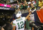 Green Bay Packers' Aaron Rodgers high fives fans as he leaves the field after an NFL football game against the Chicago Bears Thursday, Sept. 5, 2019, in Chicago. The Packers won 10-3. (AP Photo/Charles Rex Arbogast)