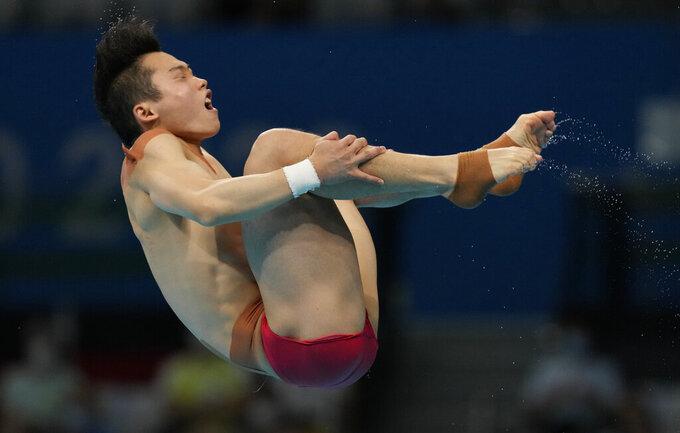 Wang Zongyuan of China competes in men's diving 3m springboard final at the Tokyo Aquatics Centre at the 2020 Summer Olympics, Tuesday, Aug. 3, 2021, in Tokyo, Japan. (AP Photo/Dmitri Lovetsky)