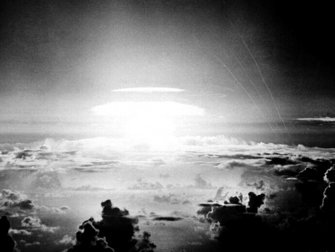 FILE - In this May 21, 1956, file photo, the fireball of a hydrogen bomb lights the Pacific sky a few seconds after the bomb was released over Bikini Atoll. A Texas-based company is facing criticism for naming a beer after the location of nuclear tests that resulted in the contamination of a Pacific island chain, a report said. Manhattan Project Beer Company is under scrutiny by Marshall Islanders who were exposed to high levels of radiation by U.S. government research from 1946 to 1958, The Pacific Daily News reported Thursday, Aug. 15, 2019. (AP Photo, File)
